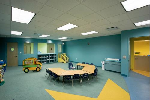Contemporary nursery and private mother's nursing room