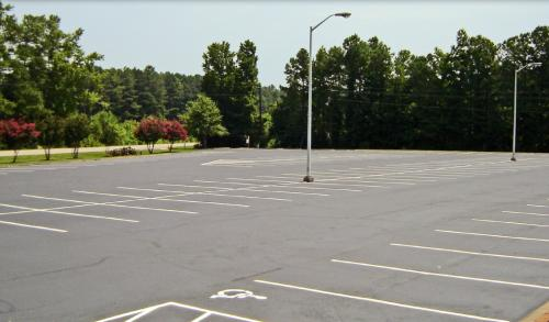 A paved, amply sized, parking lot
